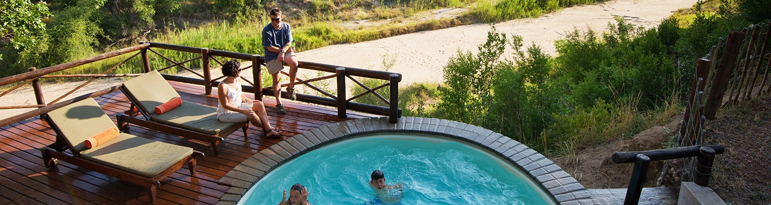 Private swimming pool with family at Indlovu River Lodge Luxury Accommodation near Hoedspruit